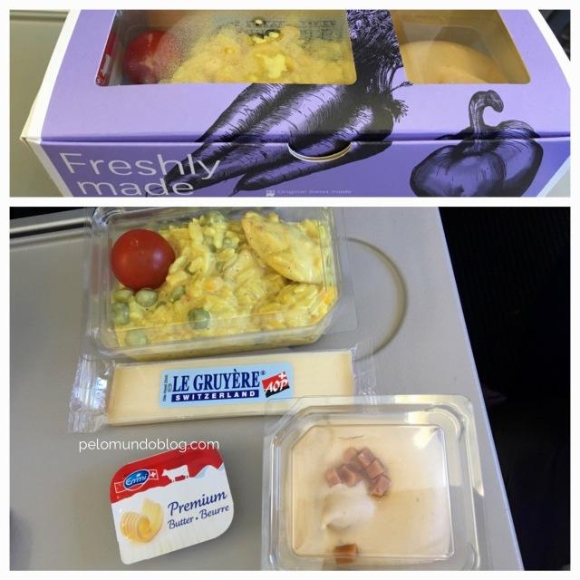 Refeição do voo Zurique - Lisboa. Como nosso voo saiu às 12h de Zurique, serviram uma refeição e não lanche. Era um arroz com frango e curry, gelado. Parecendo uma salada.